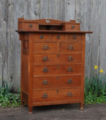 Unique Arts and Crafts period eleven drawer highboy dresser chest with Macmurdo feet and heart cut out design Stickley era